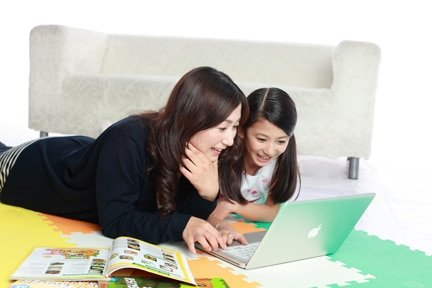 Parent helping student in online class