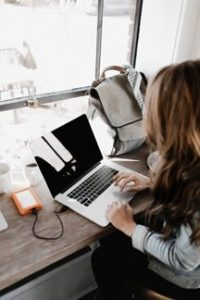 Woman working from home using productivity tips for working from home