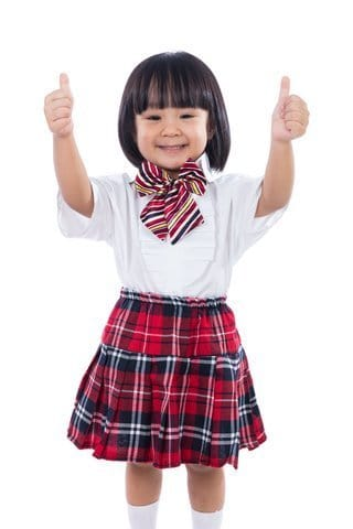 Happy Asian Chinese Little Student Girl Showing Thumbs Up